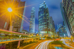 Car light trails and urban landscape in Hong Kong. Royalty Free Stock Images