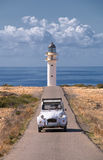 car and lighthouse royalty free stock photos