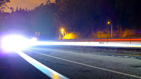 Car lights approaching Royalty Free Stock Photos