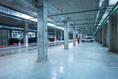 Car lights in the big underground city parking. Royalty Free Stock Images
