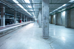 Car lights in the big underground city parking. Royalty Free Stock Image