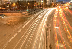Car lights on the central city streets. Royalty Free Stock Image