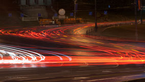 Car lights on the central city streets at evening time. Longexposure Royalty Free Stock Images