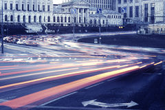 Car lights on the central city streets. Royalty Free Stock Images