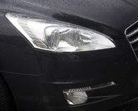 Car lights. Car eye in black color Royalty Free Stock Photos