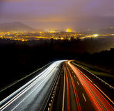 Car lights going to the city Royalty Free Stock Images