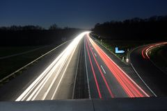 Car lights on highway Royalty Free Stock Photo
