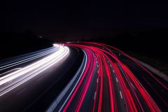 Car lights on highway with a dark night royalty free stock photography
