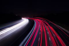 Car lights on highway with a dark night stock photography