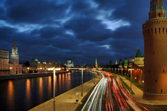 Car Lights of Moving Traffic at Revamped Kremlin Embankment. View from Bolshoi Moskvoretsky Bridge on the bright new street lights and lines of car lights at the Royalty Free Stock Image