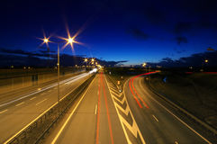 Car lights at night. On highway Royalty Free Stock Photography