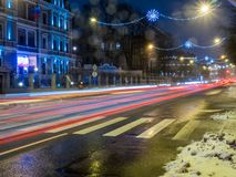 Car lights at night on ice road in snow winter Stock Images