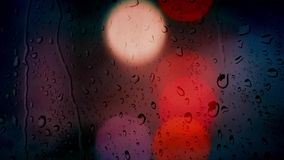 Car Lights At Night Rain Bokeh. View through window with raindrops of car lights stock video