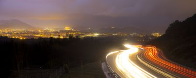 Car lights at night on the road going to the city. Donostia, Basque Country, Euskadi, Spain Stock Photos