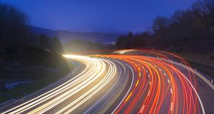 Car lights at night on the road going to the city Royalty Free Stock Photography