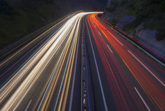 Car lights at night on the road in the highway Royalty Free Stock Photography