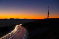 Car lights at night towards the city Stock Photography