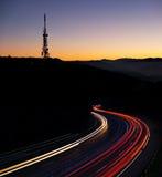 Car lights at night towards the city Royalty Free Stock Image