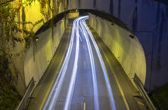 Car lights passing through a tunnel in the city. Stock Images