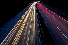 Car lights on road at night. Blurred car lights on road or motorway at night royalty free stock images