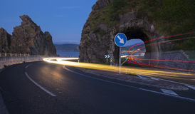 Car lights on a road tunnel Stock Photography