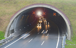 Car lights running in a road tunnel, Stock Image