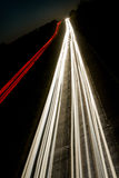 Car lights trails. On the buisy highway in the deep dusk Stock Photography