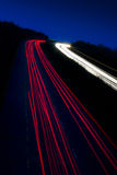 Car lights trails. On the buisy highway in the deep dusk Stock Images