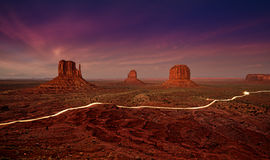 Car lights trails in Monument Valley at night. Stock Photos