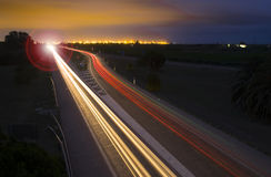 Car lights trails at night on the road. Royalty Free Stock Images