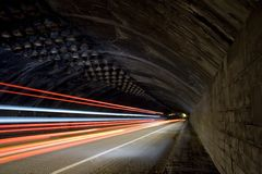 Car lights trails in a tunnel Royalty Free Stock Photos