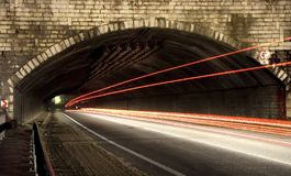 Car lights trails in a tunnel. Long exposure photo taken in a tunnel below Veliko Tarnovo Royalty Free Stock Photography