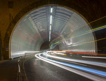 Car lights in a tunnel, city at night. Stock Image