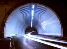 Car lights in a tunnel, city at night. Royalty Free Stock Image
