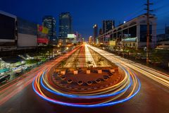 Car lights with U turn road in Sutthisan district with architecture buildings in transportation concept. Urban city, Bangkok at stock photography