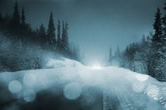 Car lights in winter Stock Image