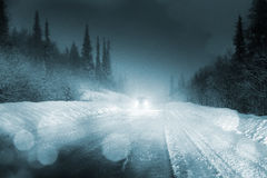 Car lights in winter Royalty Free Stock Image