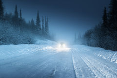 Car lights in winter Royalty Free Stock Photo