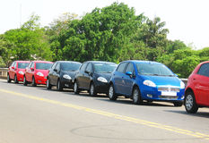 Car Line. Same type of cars parked in one single line on the road Royalty Free Stock Photography