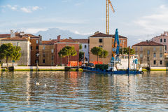 Car Loading onto Ferry in Venice. An old ferry in a Venice canal with car driving onto rear Royalty Free Stock Photo