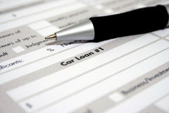 Car loan. Application form with  pen on it Royalty Free Stock Photo