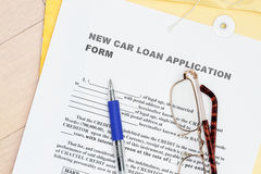 Car loan. Form with manila envelop and pen royalty free stock image