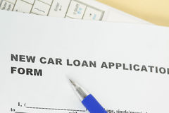 Car loan. Application form with ballpen and keyboard Stock Photo