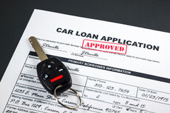 Car Loan Application Approved 002. Filled-up car loan application form with approved stamp and a remote car key royalty free stock photo