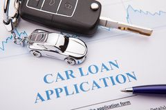 Car loan application form lay down on desk. Working stock photo