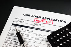 Car Loan Application Rejected 007. Filled-up car loan application form with rejected stamp, calculator and a black pen royalty free stock photos