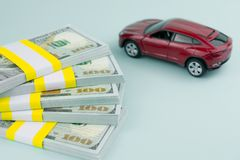 Car loan buying a new car. Purchase auto dealership and rental car, car loan buying a new car concept. red car money stock photography