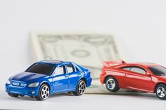 Car loan concept with toy cars and dollar bill. Finance royalty free stock images