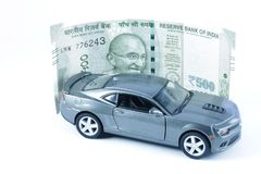 Car, Car Loan, Car Insurance, Car Expenses, Car Hire. An image depicting car loan or car insurance cover or Car related expenses. Car with coins. Car with Money Stock Images