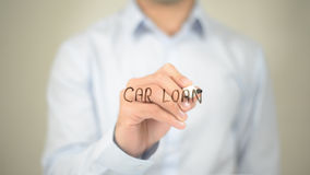 Car Loan, Man writing on transparent screen. High quality royalty free stock images